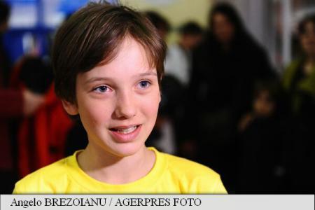 Dor Geta Popescu a devenit, la varsta de 12 ani si 5 luni, cea mai tanara persoana din lume care a cucerit cel mai inalt vulcan de pe planeta